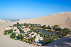 Huacachina with Ica in the Background Royalty Free Stock Photo