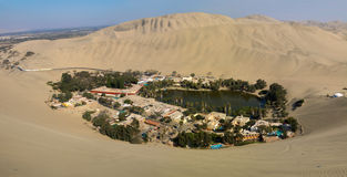 Huacachina oasis landscape. Panorama. Windy and sand over the air. Ica desert, Peru Stock Photos