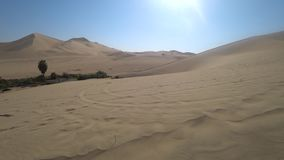 Tourists on sand dune buggy over the dunes in Huacachina desert, Peru stock footage