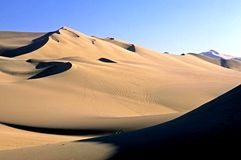 Huacachina Sand dunes. This image was shot in Huacachina, Peru and shows the sand dunes surrounding the area Stock Image