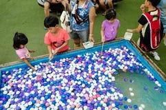 HUAHIN, Thailand : Children choose balls. Plernwan One of popular vintage market landmark and many ativity located at Petchkasem Road Royalty Free Stock Photos
