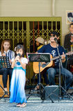 HUAHIN, Thailand : Little girl singing. In Plernwan One of popular vintage market landmark and many ativity located at Petchkasem Road Stock Photo