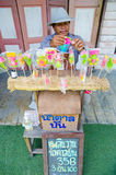 HUAHIN, Thailand : Man made and selling candy. At Plernwan One of popular vintage market landmark and many ativity located at Petchkasem Road Stock Image