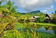 Huahine, Maitai Lapita Village. Resort bungalows and lily pond royalty free stock photo