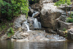 Huai Yang. Small waterfall with water motion in deep rain forest Stock Photo