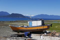 Artisanal fishing boats in Hualaiué, Los Lagos region, Southern Chile. Hualaiué is a remote cove in the Province of Palena, Los Lagos region. One of the stock images