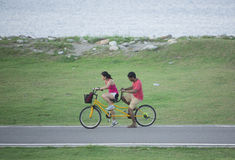 Hualien,Taiwan-June 10:Young couple ride bicycle along the seasi Stock Image