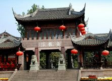 Huang Long Xi, China: Great Scenic Entry Gate. A massive stone great entry gate with its flying eave roofs and hung with traditional red Chinese lanterns flanked stock image