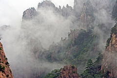 Huang Shan Mountains hidden in mist Stock Photo