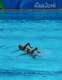 Huang Xuechen en de Zon Wenyan van team China concurreren tijdens gesynchroniseerde het zwemmen dueten vrije routine inleidend va Royalty-vrije Stock Foto's