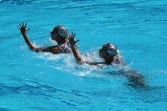 Huang Xuechen en de Zon Wenyan van team China concurreren tijdens gesynchroniseerde het zwemmen dueten vrije routine inleidend va Royalty-vrije Stock Fotografie