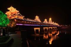 Huang Zhou Feng Yuqiao night. Popular in Hunan, Hubei, Guizhou, Guangxi etc.. All timber deck planking, built on both sides, railings, benches, roof tile forming stock photo