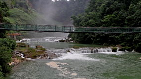 Huangguoshu Waterfall and the suspension bridge stock video
