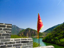 Huanghuacheng Lakeside Great Wall section. Huanghuacheng Lakeside Great Wall one section with red flag on it on the mountain in Beijing China on a sunny day Stock Photography