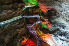 Huanglong cave formations and walkway. Huanglong cavern with small walkway lit up by colorful lights. Zhangjiajie, china Stock Photos
