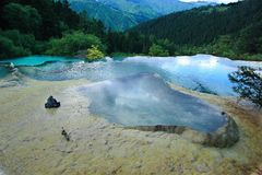 Huanglong Scenic Area. Limestone formations and hot springs in a forest along the Huanglong Valley, China Royalty Free Stock Photography