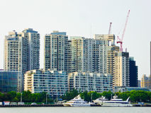 Huangpu river sightseeing boats in Shanghai. Huangpu river yacht with tall modern apartments buildings background in Shanghai China Royalty Free Stock Image