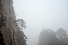 Huangshan Mountain in thick fog Stock Photo