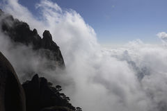 Huangshan sea of clouds wonders in China. Billowing white clouds, clear the skyline, mountain peaks, steep and beautiful royalty free stock photography