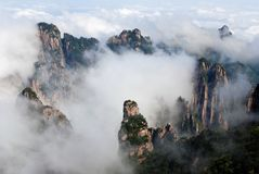 Huangshan (yellow mountain). Huangshan(also called yellow mountain) in Anhui province of China. This photo was taken after a rain. The fog was rising with Stock Photo