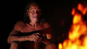 Huaorani Hunter Resting By The Fire stock video