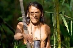 Huaorani Indigenous Hunter In Amazon Basin. Typical Huaorani Hunter Portrait Waorani Reserve Yasuni National Park Ecuador Shoot In The Jungle In Ambient Light Stock Photo