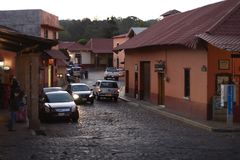 Cobblestone street in Huasca de Ocampo. Huasca de Ocampo, Hidalgo, Mexico - 2019: A typical cobblestone street at the town center royalty free stock images
