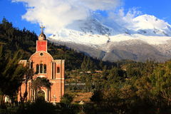 Huascaran Mountain. In the foreground a church that is in the cemetery at the foot of Mount yungay impressive huascaran the highest mountain in Peru Royalty Free Stock Images