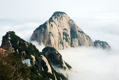 Huashan mountain in the clouds Stock Photos