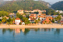 Huatulco beach scene Mexico. Scenic view of resort buildings by beach on coastline of Huatulco, Mexico