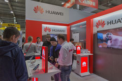 Huawei company booth at CEE 2015, the largest electronics trade show in Ukraine. People visit Huawei, Chinese electronics manufacturer company booth during CEE royalty free stock photo