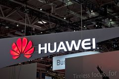 Huawei company logo on the wall. Huawei Technologies Co. is a Chinese multinational networking and telecommunications Royalty Free Stock Images