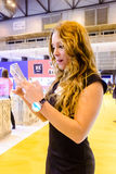 Huawei with Grupo Ayserco launch classical look electronic watch at JoyaMadrid, Madrid Spain. A Huawei assistant synchronising her electronic watch with her royalty free stock image