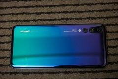 Huawei p20 pro in the twilight color stock images