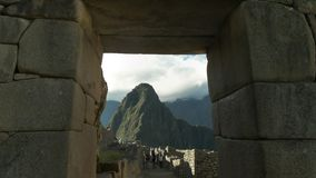 Huayna Picchu framed by a stone doorway at Machu Picchu