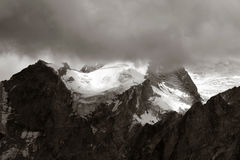 Huayna Potosi. Rain clouds hiding the peak of Huayna Potosi in Bolivian Andes Stock Photo