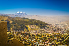 Huayna Potosi in Bolivia. Photo of crowded city and greenery in valley under Huayna Potosi, mountain in Bolivia, South America stock photography