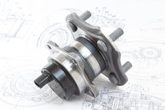 Hub with bearing. And ABS sensor on the background of drawings and plans Stock Photo