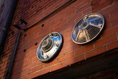 Hub caps mounted on brick wall stock images