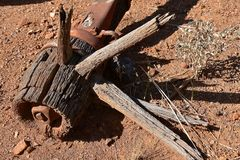 Old rotting wooden wheel with spokes and hub. Hub, rim, and spokes of an old wheel supporting a rotting weathered wood wagon Stock Photos