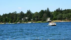 Hubbard County, Mn - 26 Jul 2019: A beautiful northern Minnesota lake with wooded shoreline on a sunny day. Hubbard County, Mn - 26 Jul 2019: A beautiful stock video footage