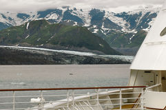 Hubbard Glacier from cruise ship deck. View of Hubbard Glacier in Alaska from the deck of a cruise ship with mountains in the background Stock Photo