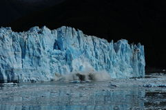 Hubbard Glacier (3 of 4). Glacial calving. Significant ice falling from the Hubbard Glacier in Alaska stock images
