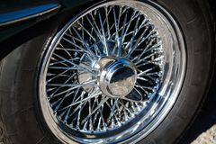 Hubcaps from a oldtimer, green english car. Transport royalty free stock photo