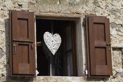 Hublot avec le coeur Photos stock