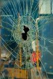 Verre cassé criqué avec le trou Photos libres de droits