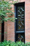 Hublot décoré d'architecture de brique Photographie stock libre de droits