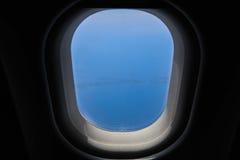 Hublot d'avion Photographie stock libre de droits