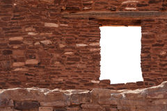 Hublot dans un mur de blocaille Photo stock
