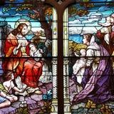 Hublot en verre souillé avec Jésus Photographie stock libre de droits